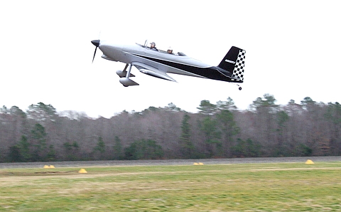 RV-8 pulling up after a low (FOD check) fly-by.