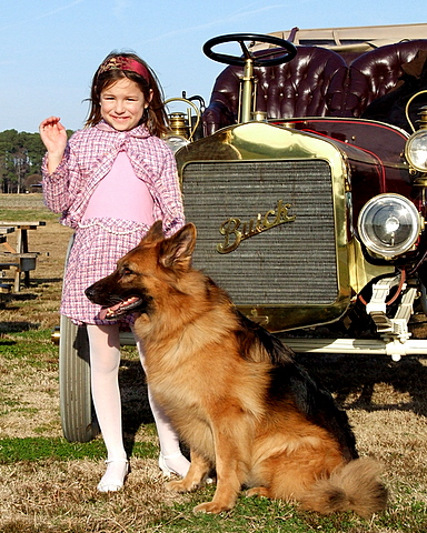 Gracie and Neo in front of the shiny 1906 Buick.