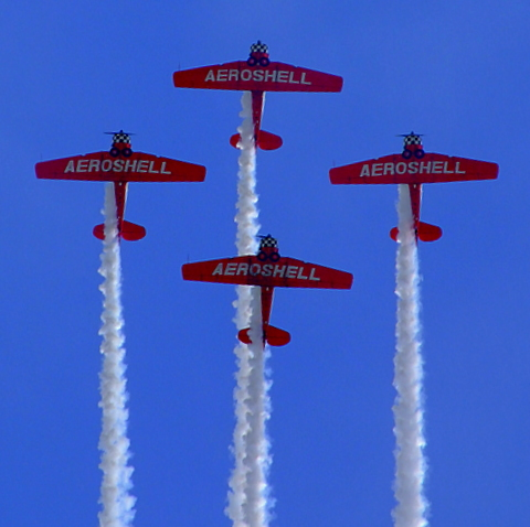 Aeroshell Flying Team in tight formation.